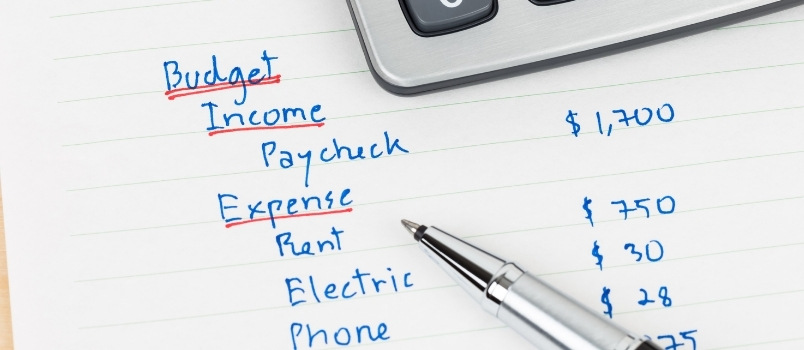 budget with income and expenses; save money monthly